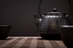 Traditional eastern teapot and teacups on wooden desk Royalty Free Stock Image