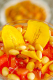 Traditional ecuadorian cold tomato based dish with chochos, onions and banana chips, elegant restaurant presentation.  Stock Photo