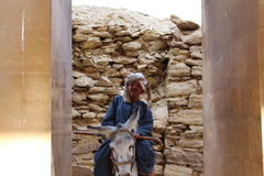 Traditional Egyptian attired man on a Donkey Stock Photography