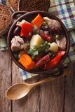 Traditional eintopf soup in the pot close up. Vertical top view Royalty Free Stock Photo