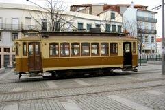 Traditional electric car. Traditional electric brown car in the streets of Oporto, Portugal Stock Photo