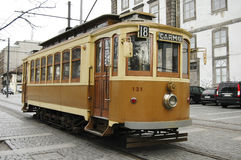 Traditional electric car. Traditional electric brown car in the streets of Oporto, Portugal Royalty Free Stock Images