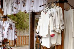 Traditional embroidered romanian blouses exposed for sale. On a vending stall royalty free stock images