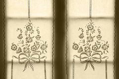 Traditional embroidered window curtain with floral pattern. Azor Stock Photo