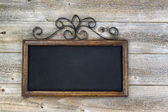 Traditional empty chalkboard on aged wood Royalty Free Stock Photos