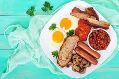Traditional English breakfast: bacon, mushrooms, eggs, tomatoes Royalty Free Stock Image