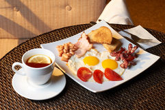 Traditional English breakfast with beans, eggs, vegetables, bacon and toast. Stock Photography