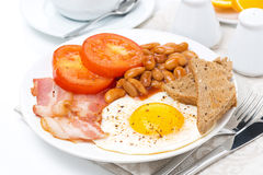 Traditional English breakfast with fried egg, bacon Royalty Free Stock Photography