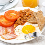 Traditional English breakfast with fried eggs, bacon, beans Royalty Free Stock Images