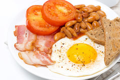 Traditional English breakfast with fried eggs, bacon, beans Stock Photos