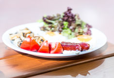 Traditional English breakfast with fried sausage and eggs Royalty Free Stock Images