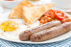 Traditional English breakfast with sausages, selective focus Stock Image