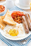 Traditional English breakfast with sausages, vertical Stock Photography