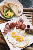 Traditional english british fried breakfast with eggs bacon and royalty free stock images