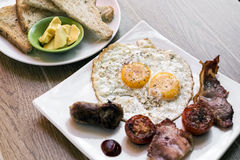 Traditional english british fried breakfast with eggs bacon and stock images