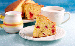 Traditional English cherry cake,. Sliced on plate Royalty Free Stock Image