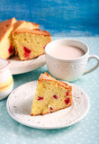 Traditional English cherry cake. Sliced on plate Stock Images
