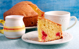Traditional English cherry cake. Sliced on plate Stock Photos