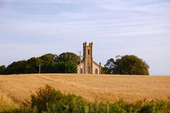 Traditional English church in fields Royalty Free Stock Photography