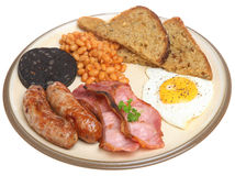 Traditional English Cooked Breakfast. Full English fried breakfast with sausages, beans, bacon, black pudding and fried egg Royalty Free Stock Images