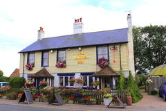 Traditional English Country Pub New Romney Kent UK. Beautiful decorated the Warren Inn, Romney Marsh, Kent  A Traditional Country Pub by A259 coastal road United Royalty Free Stock Images