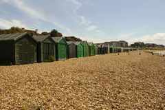Traditional English family Beach Huts at the pebble beach at Titchfield in Hampshire in the South of England stock image
