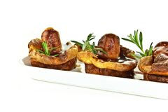 Traditional English fayre, Yorkshire pudding and grilled sauages with rosemary, nationally referred to as Toad In The Hole. Served royalty free stock image
