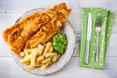 Traditional english food - Fish and chips with mushy peas Royalty Free Stock Photos
