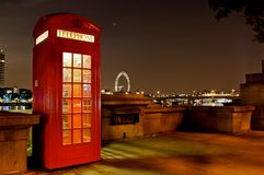 Traditional english phone booth with the London Center in the ba. Ckground Royalty Free Stock Photography
