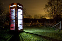 Traditional english phonebox at night Royalty Free Stock Photo