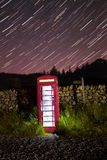 Traditional english phonebox at night Stock Image
