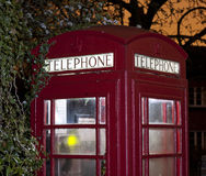 Traditional english phonebox at night Royalty Free Stock Photography