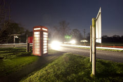 Traditional english phonebox at night Stock Photos