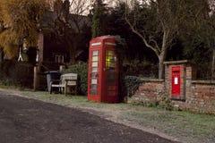 Traditional english phonebox at night Stock Photo