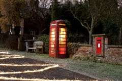 Traditional english phonebox at night Royalty Free Stock Photos