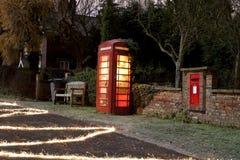 Traditional english phonebox at night Royalty Free Stock Photos