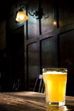 Traditional English Pub. A lone beer glass in a darkened atmospheric English Pub Royalty Free Stock Photo