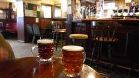 A traditional English pub. 2 pints of ale in a traditional English pub Stock Photo