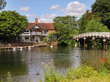 Traditional English Riverside House and Footbridge Stock Photos
