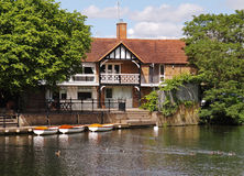 Traditional English Riverside House and Moorings Royalty Free Stock Image