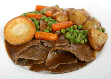 Traditional English roast with Yorkshire pudding & summer veg Stock Photos