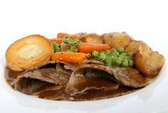 Traditional English roast with Yorkshire pudding & summer veg Royalty Free Stock Image