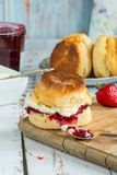 Scones with strawberry jam and clotted cream. Traditional English scones with strawberry jam and clotted cream Royalty Free Stock Image