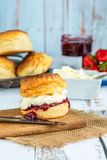 Scones with strawberry jam and clotted cream. Traditional English scones with strawberry jam and clotted cream Stock Photo