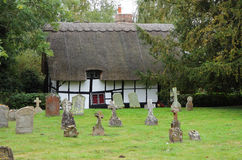 Traditional English Thatched Village Cottage Stock Image