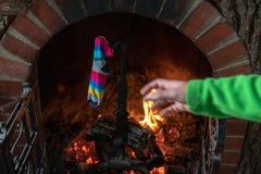 Traditional epiphany stocking set up holding on fireplace royalty free stock photo
