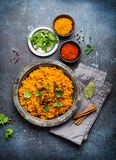 Traditional Esstern rice dish Pilaf. Pilaf - traditional Eastern/Asian dish made with rice, vegetables and meat served on vintage plate with fresh cilantro stock photo