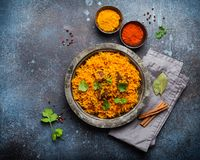 Traditional Esstern rice dish Pilaf. Pilaf - traditional Eastern/Asian dish made with rice, vegetables and meat served on vintage plate with fresh cilantro stock photography