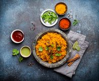 Traditional Esstern rice dish Pilaf. Pilaf - traditional Eastern/Asian dish made with rice, vegetables and meat served on vintage plate with fresh cilantro stock photos