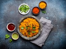 Traditional Esstern rice dish Pilaf. Pilaf - traditional Eastern/Asian dish made with rice, vegetables and meat served on vintage plate with fresh cilantro royalty free stock image